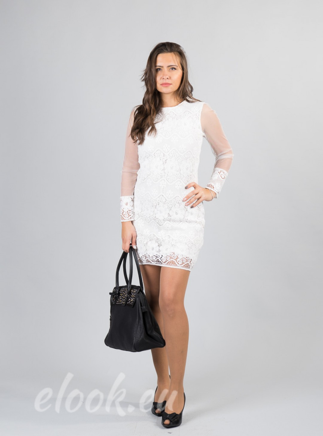 Dress in a combination of tull...